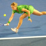 Kim Clijsters of Belgium returns against